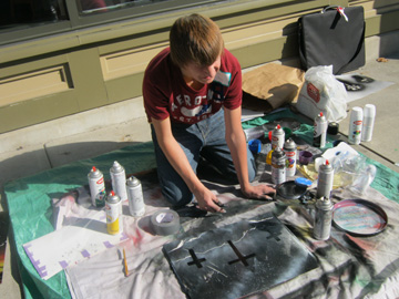 Trevor Aycox Painting outside the Good Purpose Gallery