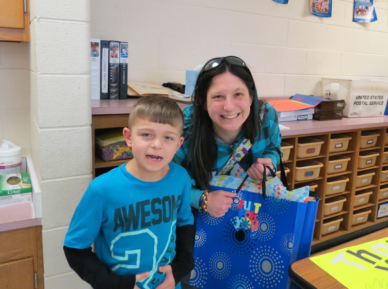 Erin gives Aiden's classroom in New Jersey an IPAD in 2012 with money she collected from making autism awareness bracelets