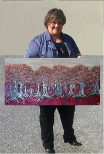 Nekea with one of her smashed glass paintings Red Riding Hood