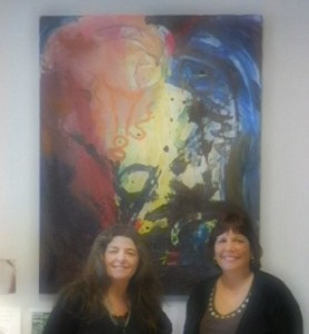 Shella and Debra at CHANCE office. Painting by Kevin Hosseini, Debra's son