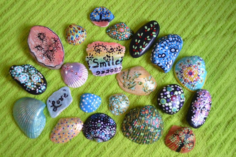 hand-painted rocks and shells